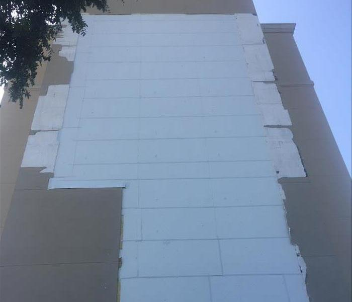 Storm damage to hotel in Fort Worth, TX After