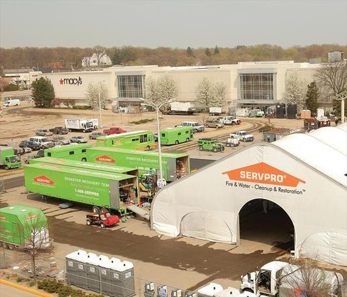 Large tent and semi trailers in Macy